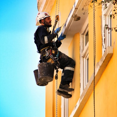 Lisbon,,Portugal-,March,19,,2019:,Young,Bricklayer,Climber,Doing,Repair