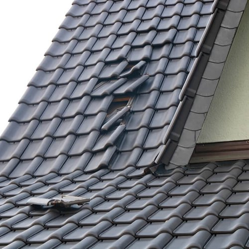 Storm,Damage,-,Slipped,Roof,Tiles,After,Hurricane