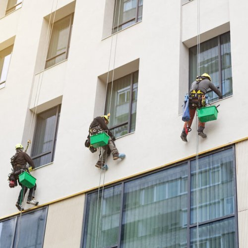 Three,Men,Climbers,Wash,Windows,Of,The,Modern,Business,Building