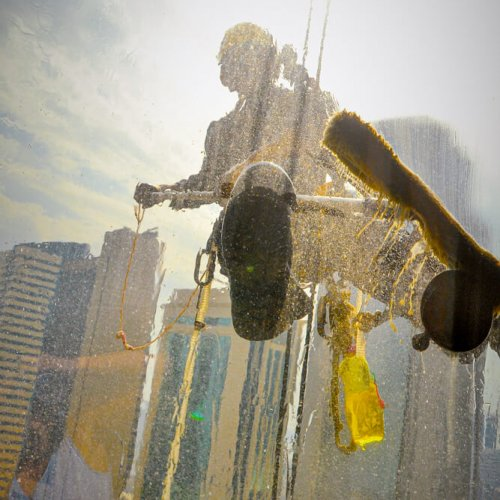 Skyscraper,Window,Cleaner,Hanging,From,A,Harness.,View,From,Inside